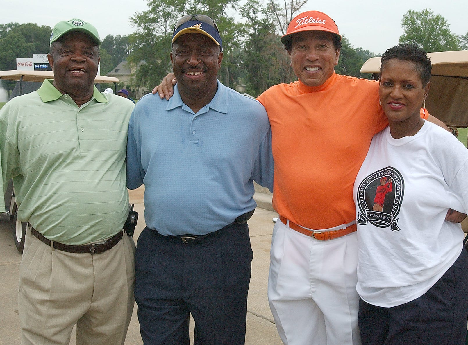 JUNE 25, 2007--Lee Elder, the first African-American to play in the PGA Masters tournament, Greg Calhoun, local businessman, singer Smokey Robinson and event coordinator Cubie Rae Hayes, from left, at the  celebrity golf tournament at Wynnlakes Golf and Country Club Monday. The event was sponsored by Calhoun Foods and Coca-Cola to raise funds for the Sickle Cell Foundation and the First Montgomery Tee. (Montgomery Advertiser, David Bundy)