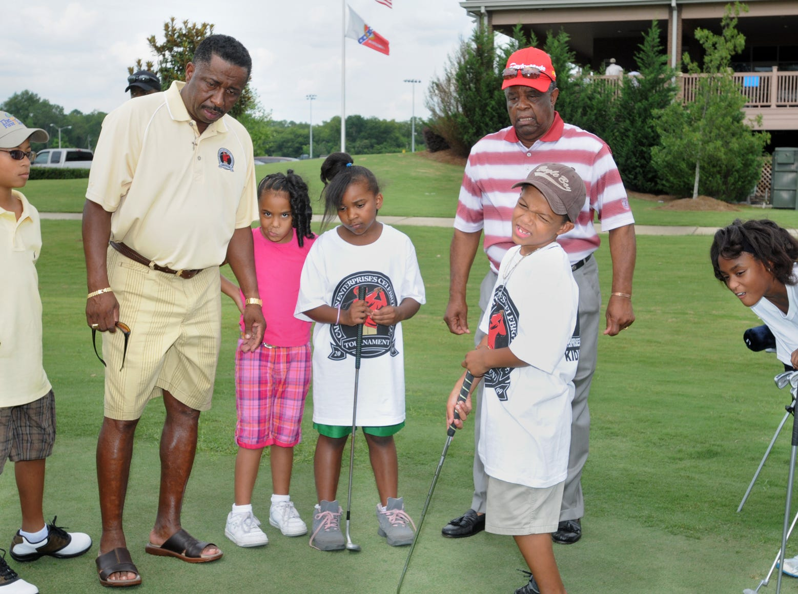 Greg Calhoun, left, and Lee Elder watch children during putting competition in the 3rd annual First Tee Golf Clinic held at Gateway Park Executive Golf Course in Montgomery, Ala. on Sunday, July 19, 2009. (Montgomery Advertiser, Lloyd Gallman)