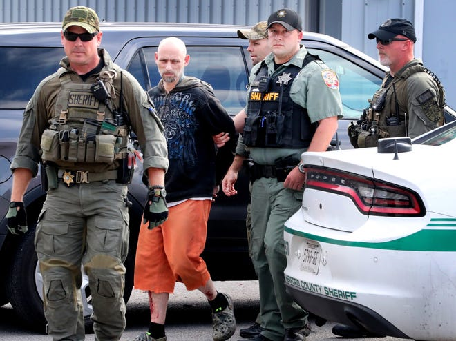 Dewayne Halfacre is escorted by Rutherford County sheriff's deputies after being captured on Oct. 11, 2018.