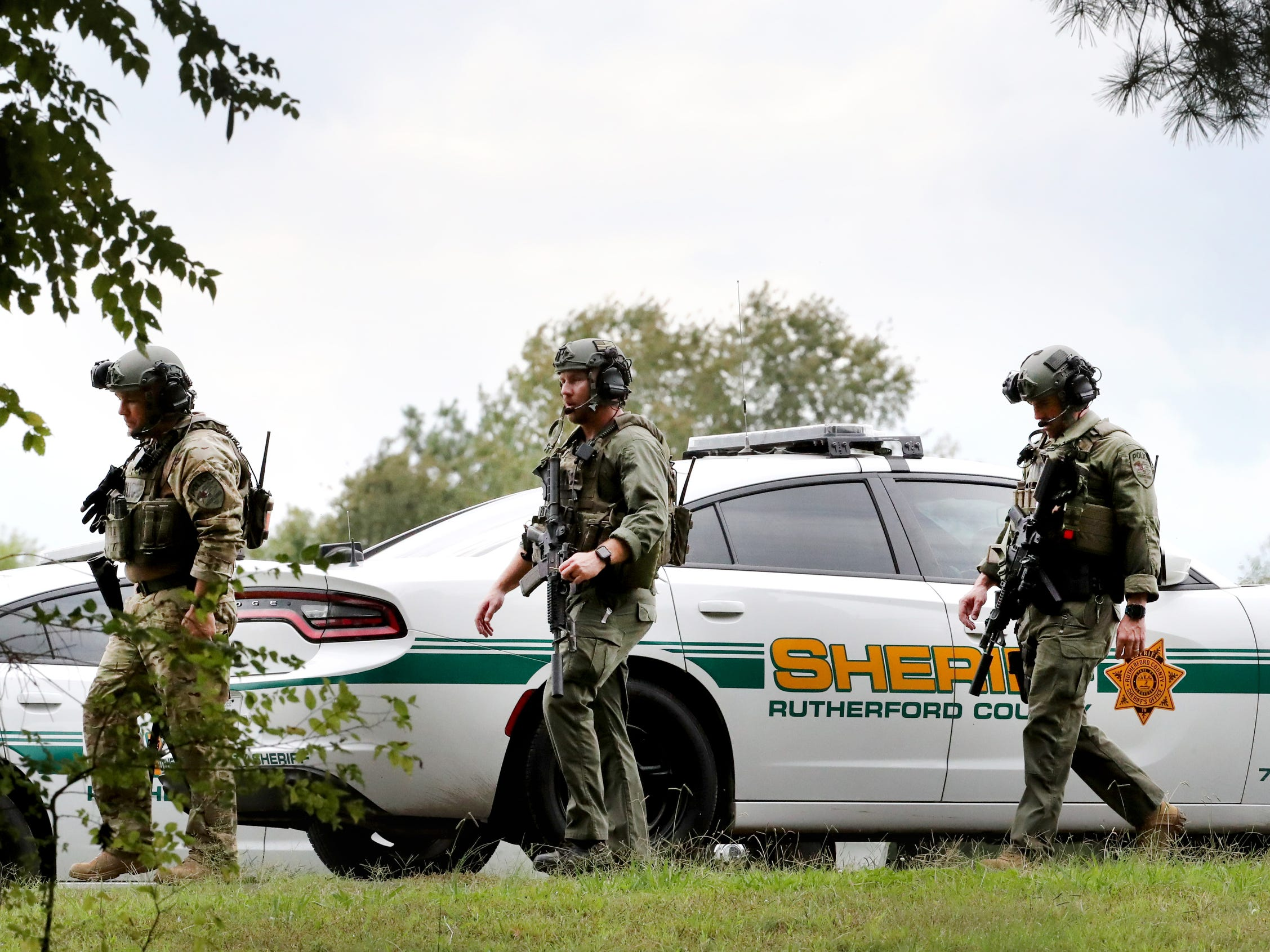 The Rutherford County Sheriff's deputies, and other law enforcement agencies searched wooded areas for two escaped inmates along Baker Road Wednesday, Oct. 10, 2018.