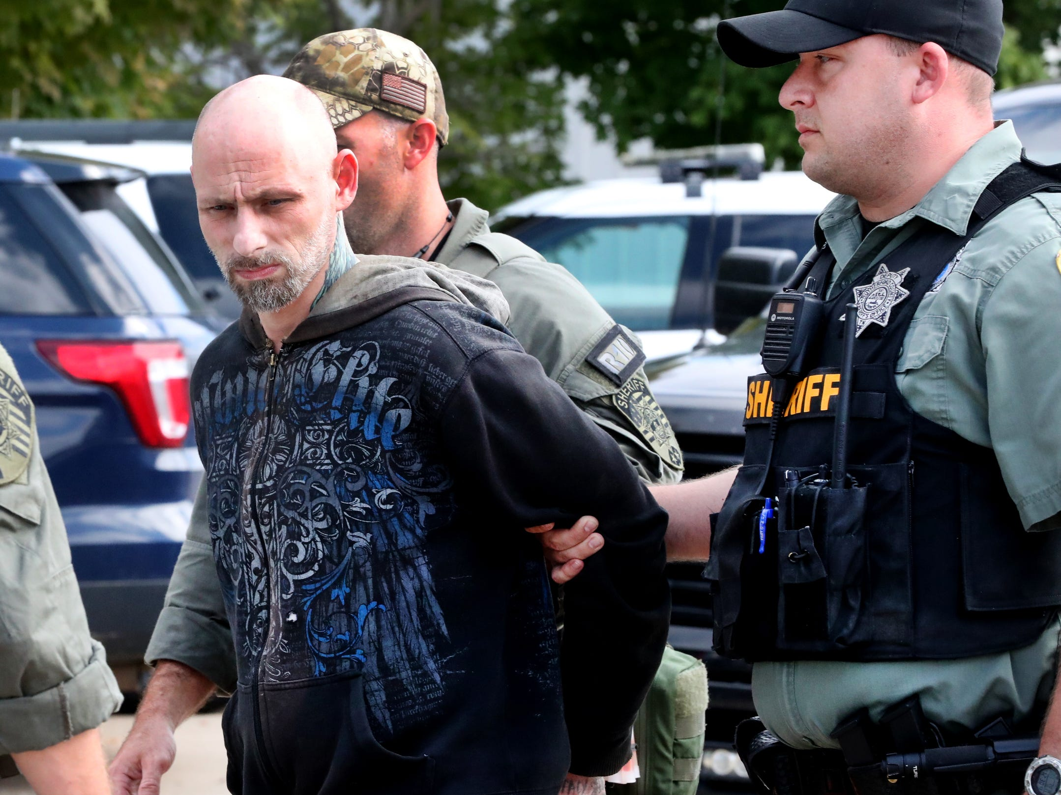 Dewayne Halfacre is escorted by Rutherford County Sheriff's Deputies after being captured Thursday, Oct. 11, 2018. Halfacre and cellmate Jonathan Baxter assaulted a deputy at the county jail before escaping early Wednesday morning, investigators said.