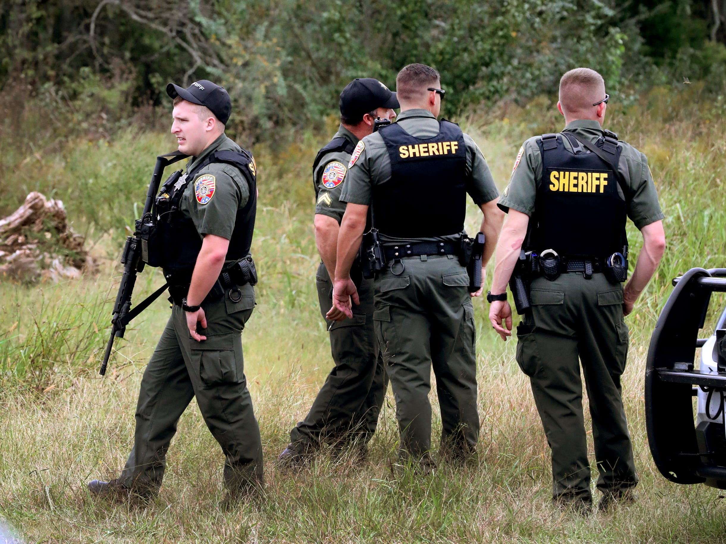 The Rutherford County Sheriff's deputies, and other law enforcement agencies searched wooded areas for two escaped inmates along Old Nashville Highway near Baker Road Wednesday, Oct. 10, 2018.