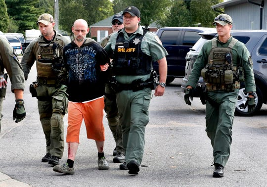 Dewayne Halfacre is escorted by Rutherford County sheriff's deputies after being captured Thursday, Oct. 11, 2018.