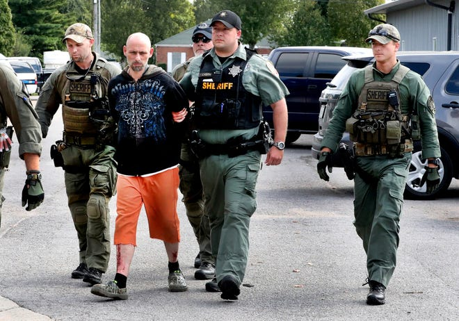 Dewayne Halfacre is escorted by Rutherford County sheriff's deputies after being captured Oct. 11, 2018. Halfacre and cellmate Jonathan Baxter assaulted a deputy at the county jail before escaping, investigators said.