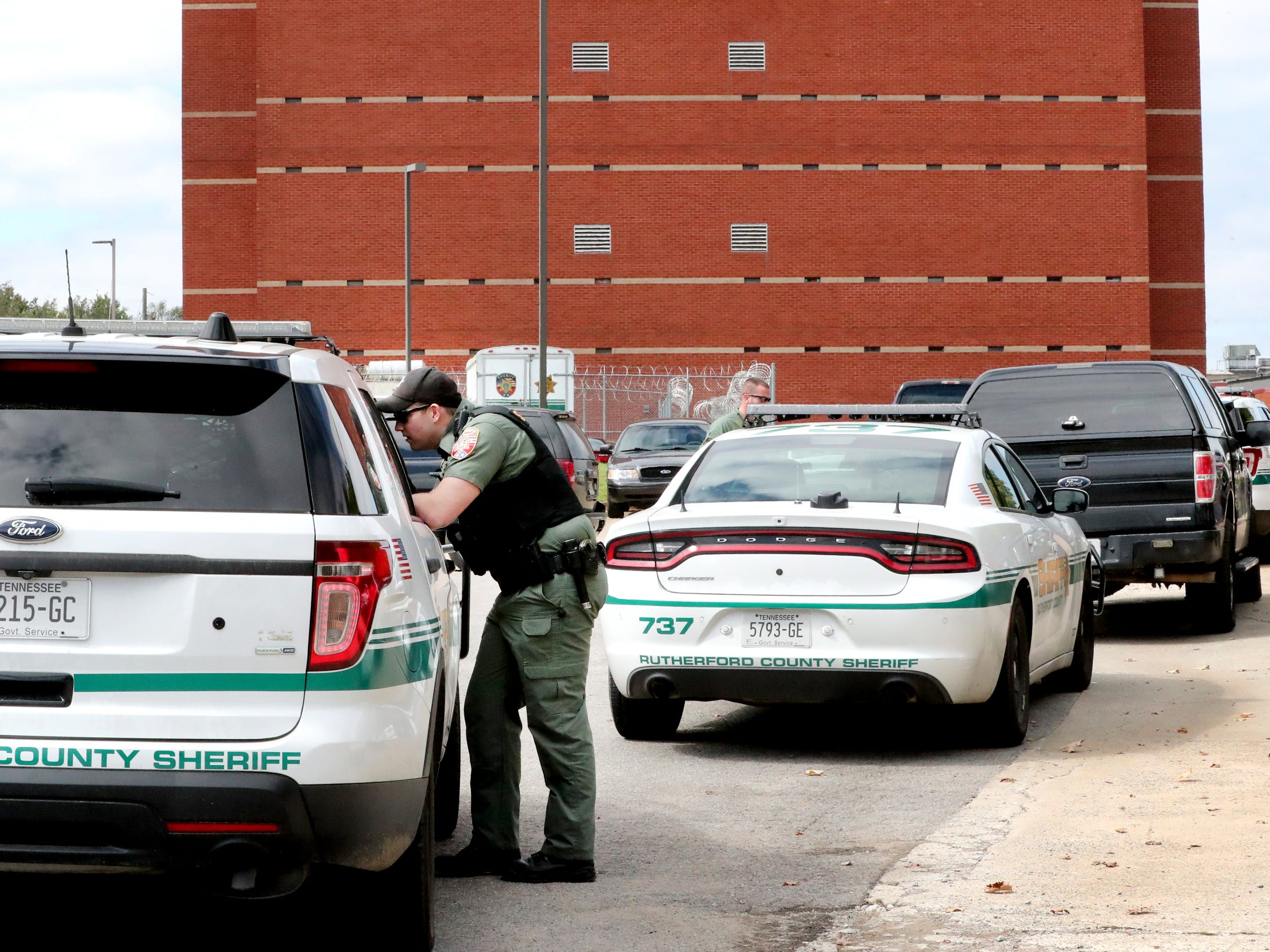 Sheriff Deputies at the Rutherford County Sheriff's Office as escapees Dewayne Halfacre and cellmate Jonathan Baxter are returned to the jail on Thursday, Oct. 11, 2018. According to officials Halfacre and Baxter assaulted a deputy at the county jail before escaping early Wednesday morning.