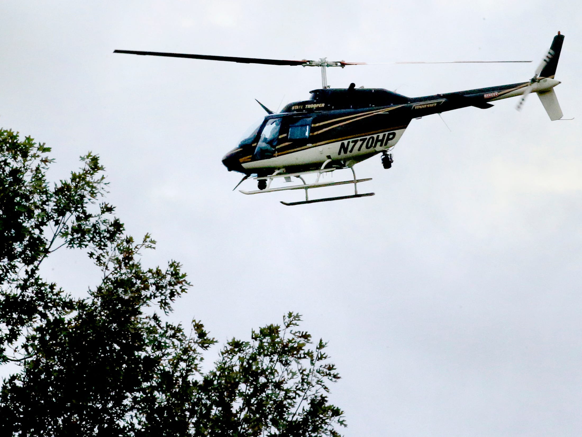 A Tennessee State Trooper helicopter  searches for two escaped inmates near Old Nashville Highway, and Baker Road Wednesday, Oct. 10, 2018