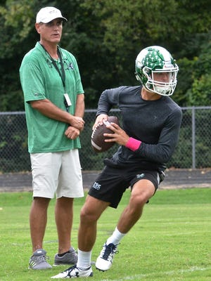 Hillwood coach Kurt Page (left) watches son Hale Page (right) at practice.