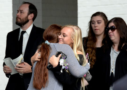 Mourners comfort each other after the funeral for Lucas Davis at the Brentwood Hills Church of Christ on Thursday.