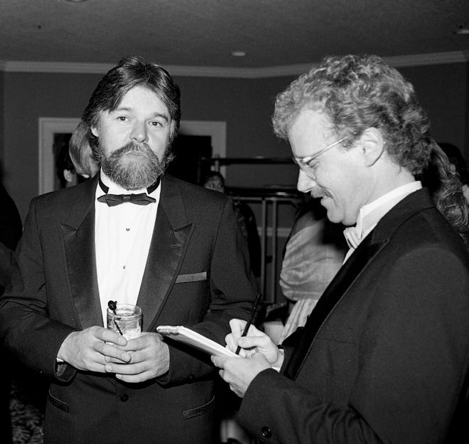 Rock superstar Bob Seger, left, answers some questions from The Tennessean music reporter Robert K. Oermann during the 22nd annual ASCP Awards banquet at Opryland Hotel Oct. 10, 1984.