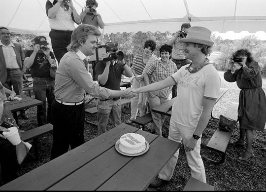 Ricky Skaggs, left, greets Tennessean music reporter Robert K. Oermann during Skaggs' private picnic and show for his fan club members June 6, 1984 during Fan Fair.