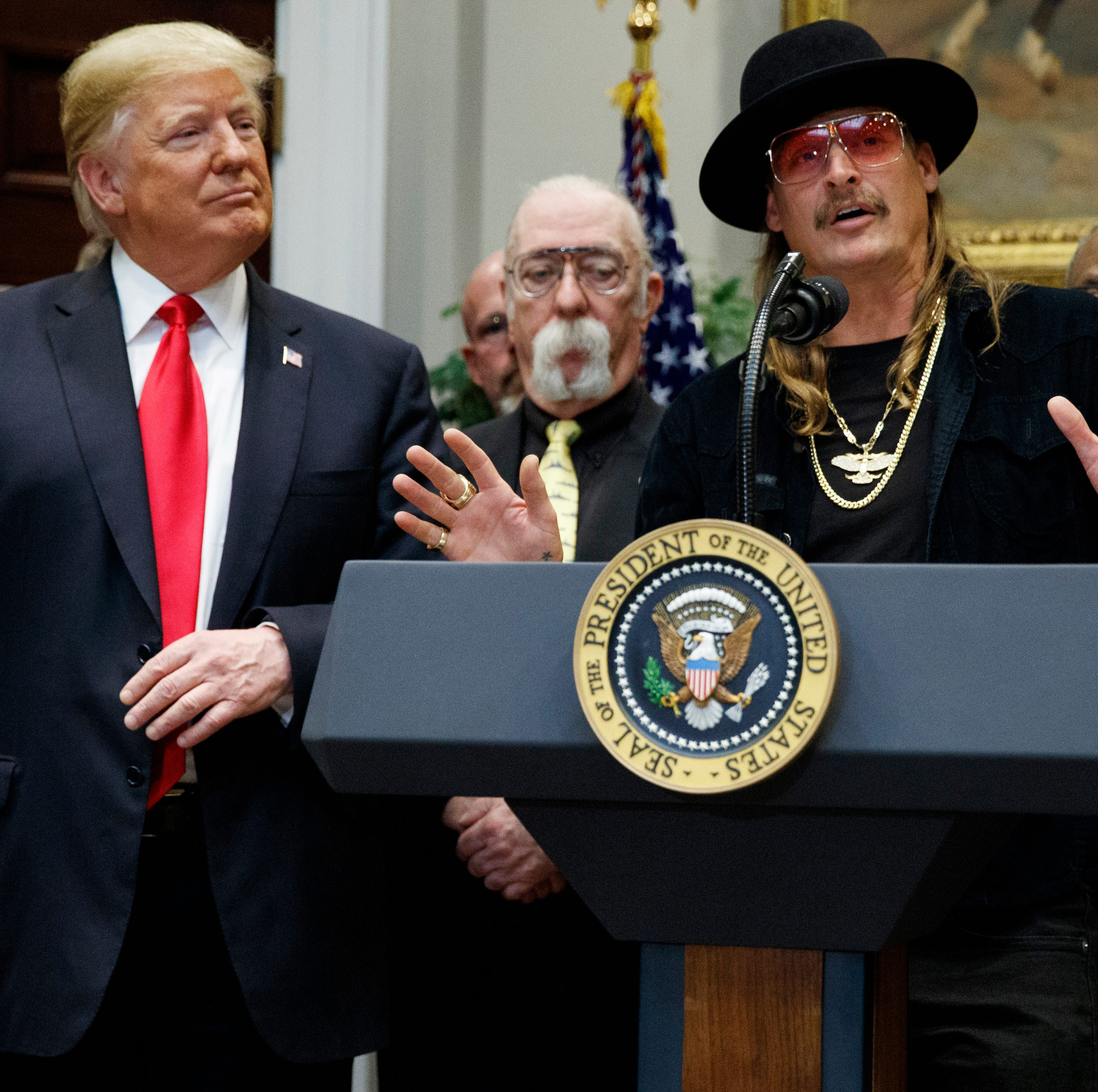 "President Donald Trump looks on as musician Kid Rock speaks during a signing ceremony for the ""Orrin G. Hatch-Bob Goodlatte Music Modernization Act"" in the Roosevelt Room of the White House on Oct. 11, 2018."