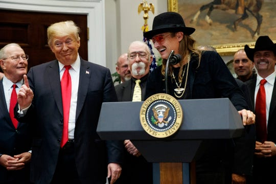 President Donald Trump gestures as musician Kid Rock speaks during a signing ceremony for the Orrin G. Hatch-Bob Goodlatte Music Modernization Act in the Roosevelt Room of the White House on Thursday, Oct. 11, 2018.