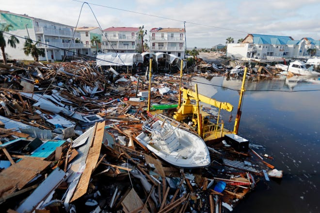 A boat sits amidst debris in the aftermath of Hurricane Michael in Mexico Beach on Thursday.