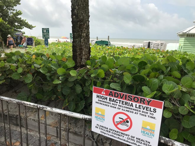 A health advisory is posted at Vanderbilt Beach on Thursday, Oct. 11, 2018, after recent testing by Collier County health officials showed elevated levels of bacteria in the water.