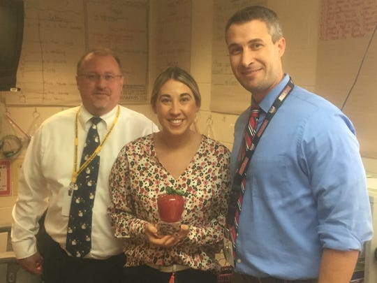 Pataskala Elementary School teacher Lauren Male was surprised with her award on Oct. 11. She is seen here with Southwest Licking Local Schools Superintendent Robert Jennell and Principal Joe Pratt.