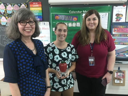 From left, Licking County Foundation's Connie Hawk, Leaders for Learning Award recipient Tiffany Smythe of the Licking County Educational Service Center, and Sarah Knaebel of LCESC at Granville Intermediate School on Oct. 10.