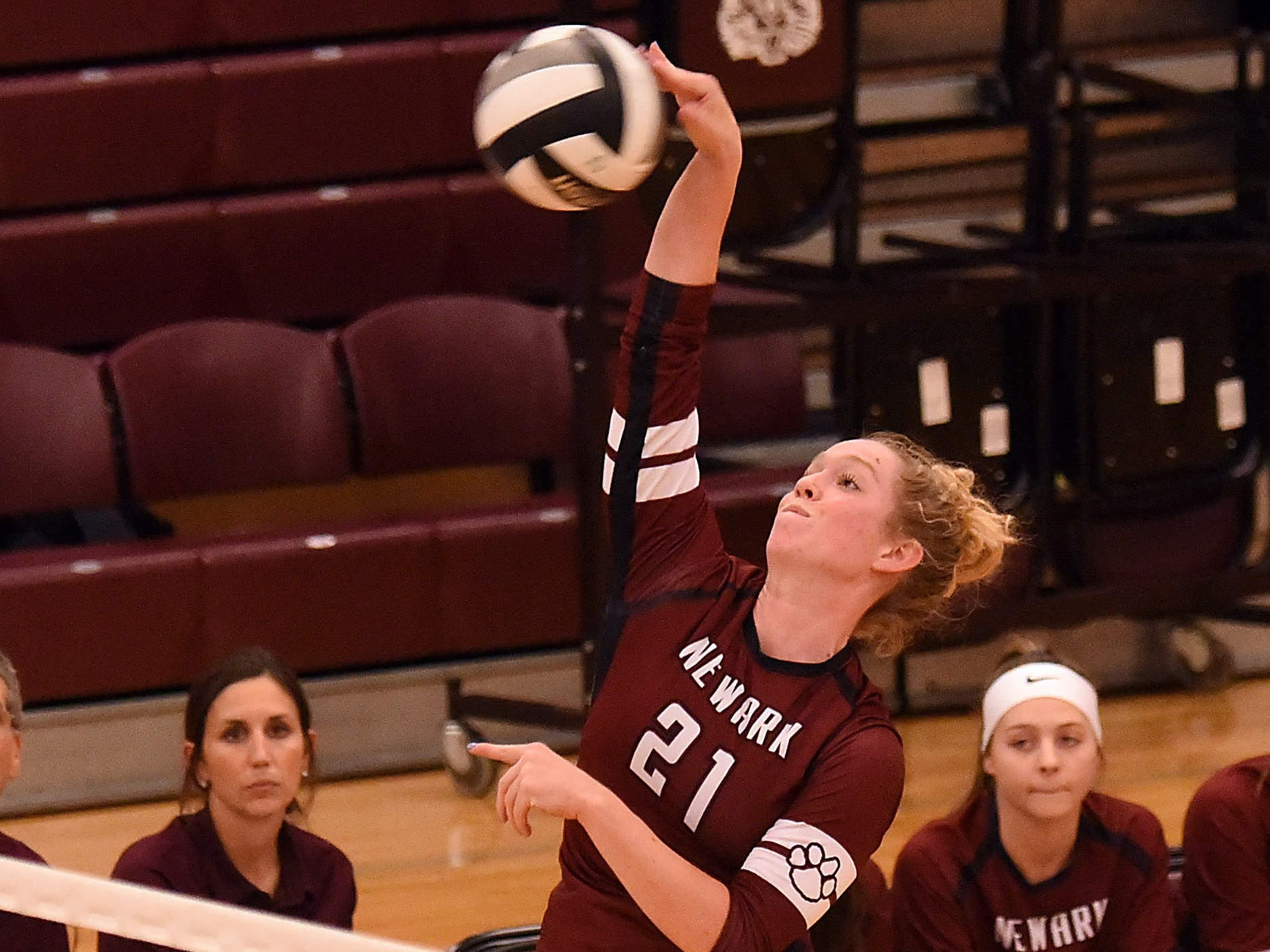 Newark's Katie Pound spikes the ball at Canal Winchester during a match on Wednesday, Oct. 10, 2018. The Wildcats lost to Canal Winchester in five sets; 25-23, 15-25, 14-25, 25-22, 15-8.
