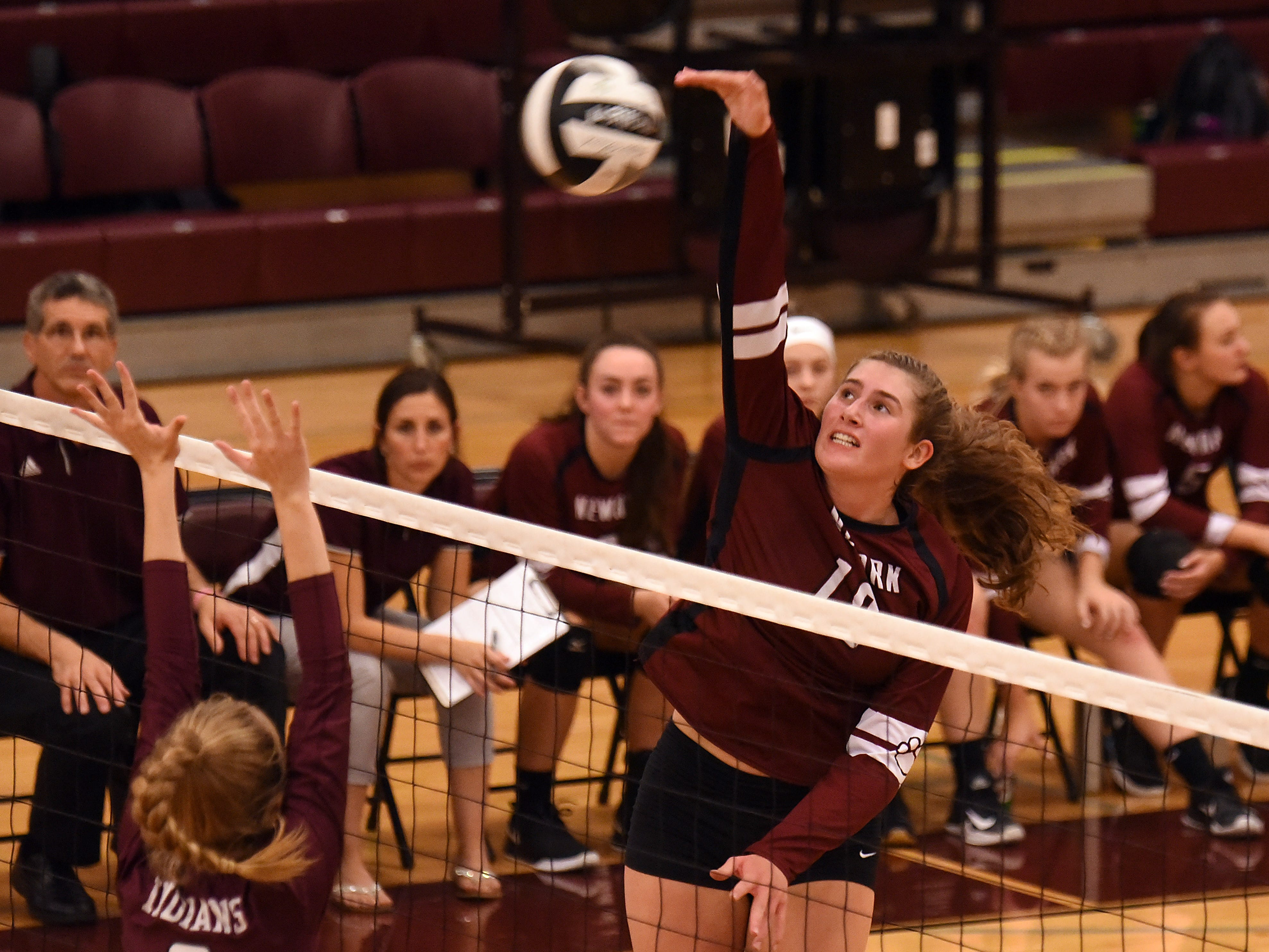 Canal Winchester blocker Riley Krueger goes up to block a hit from Newark's Kate Anderson during a match on Wednesday, Oct. 10, 2018. Newark lost to Canal Winchester in five sets; 25-23, 15-25, 14-25, 25-22, 15-8.