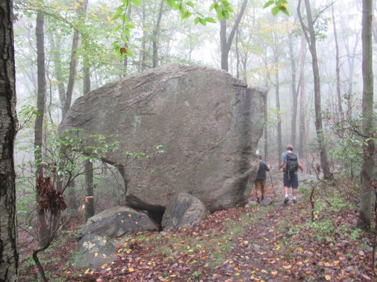 Hikers at West Pointing Rock in   Harriman State Park, N.Y.