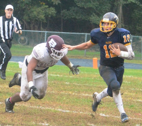 Saddle Brook quarterback Kevin Daly looking to avoid incoming Becton defensive lineman Johan Alcantara.