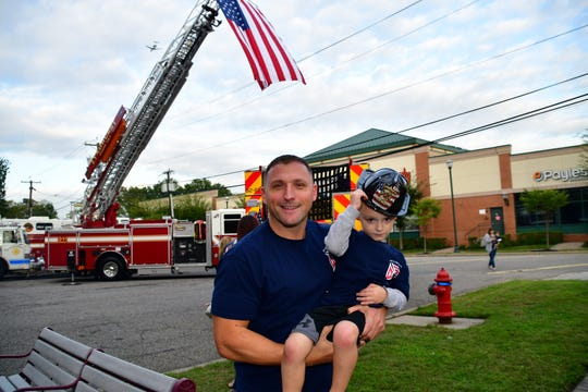Deputy Fire Commissioner Paul Haggerty celebrates the arrival of a new fire truck with his son in front of the Lyndhurst Fire Department Headquarters in 2018.