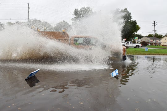 A truck barrels through the flooded right lane of River St in Little Ferry on Thursday October 11, 2018.