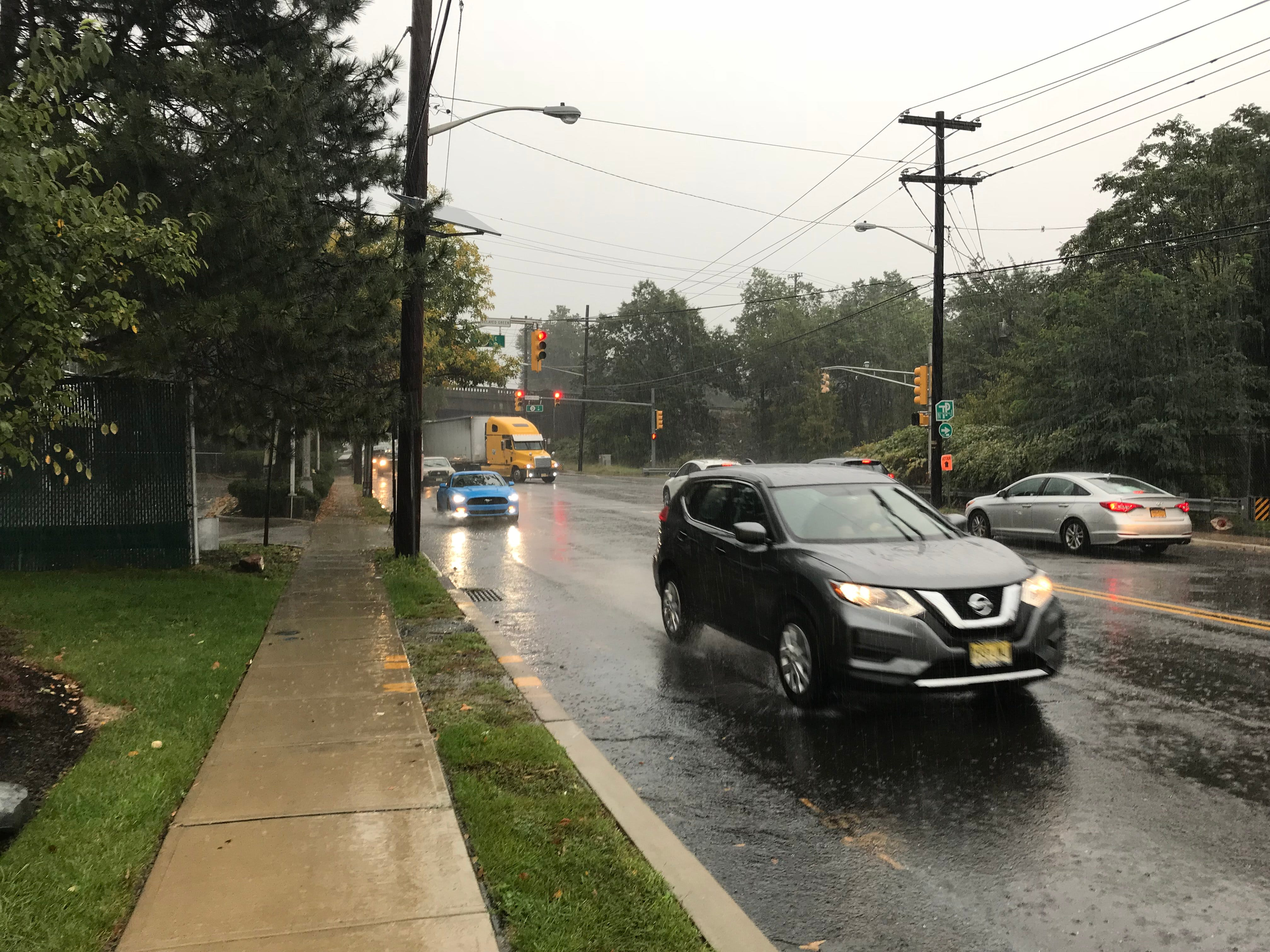 Downpours spell a messy commute home along Nutley's Passaic Avenue near the Clifton border as remnants of Hurrricane Michael hit North Jersey Thursday, Oct. 11, 2018.