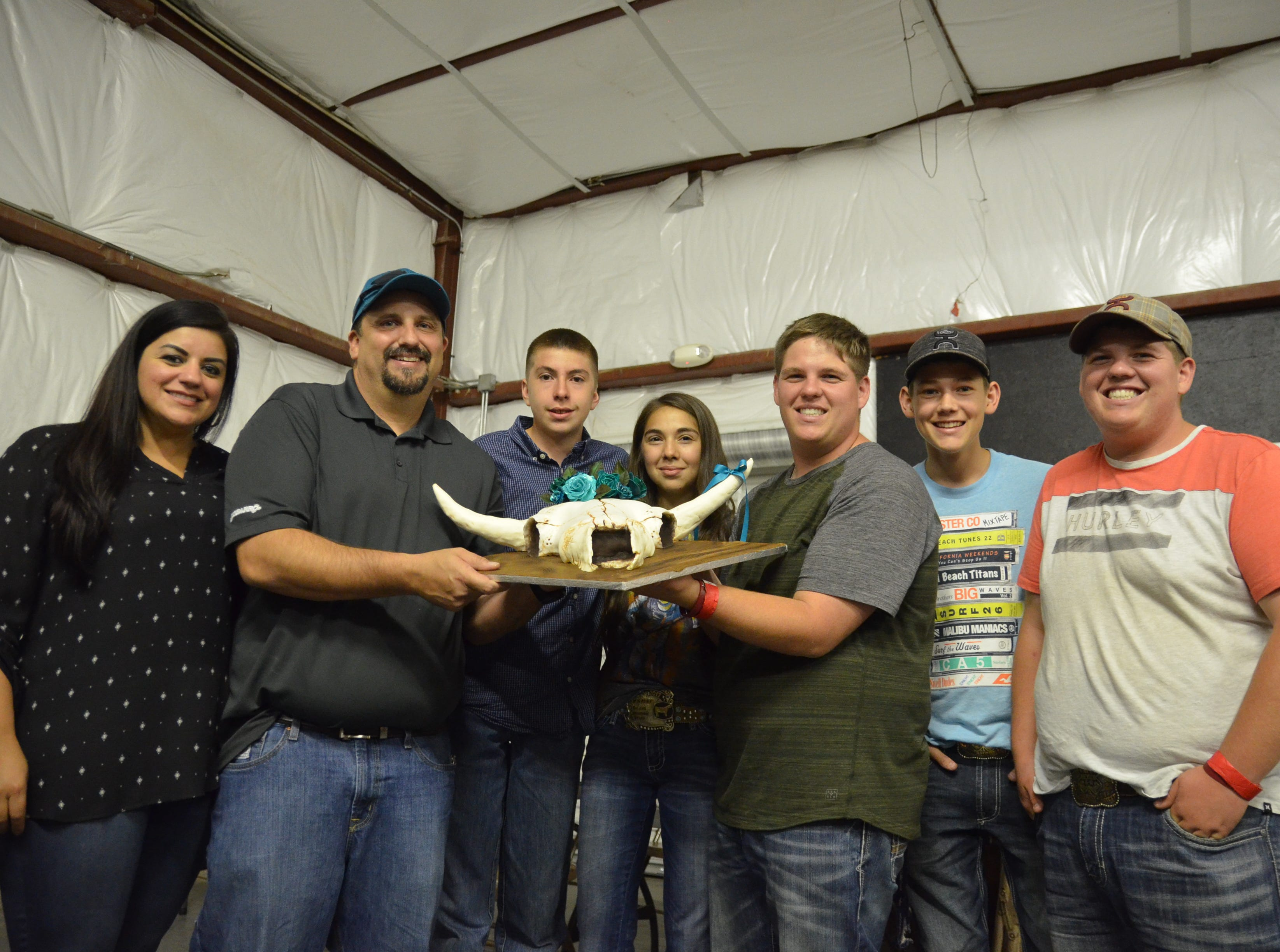 Local groups Honey Badgers, Sisbarro Super Store and Mizkan America Inc. placed the highest bid of $2,050 at the cake auction during the SWNMSF Royalty Pageant at the Luna County fairgrounds on Thursday.