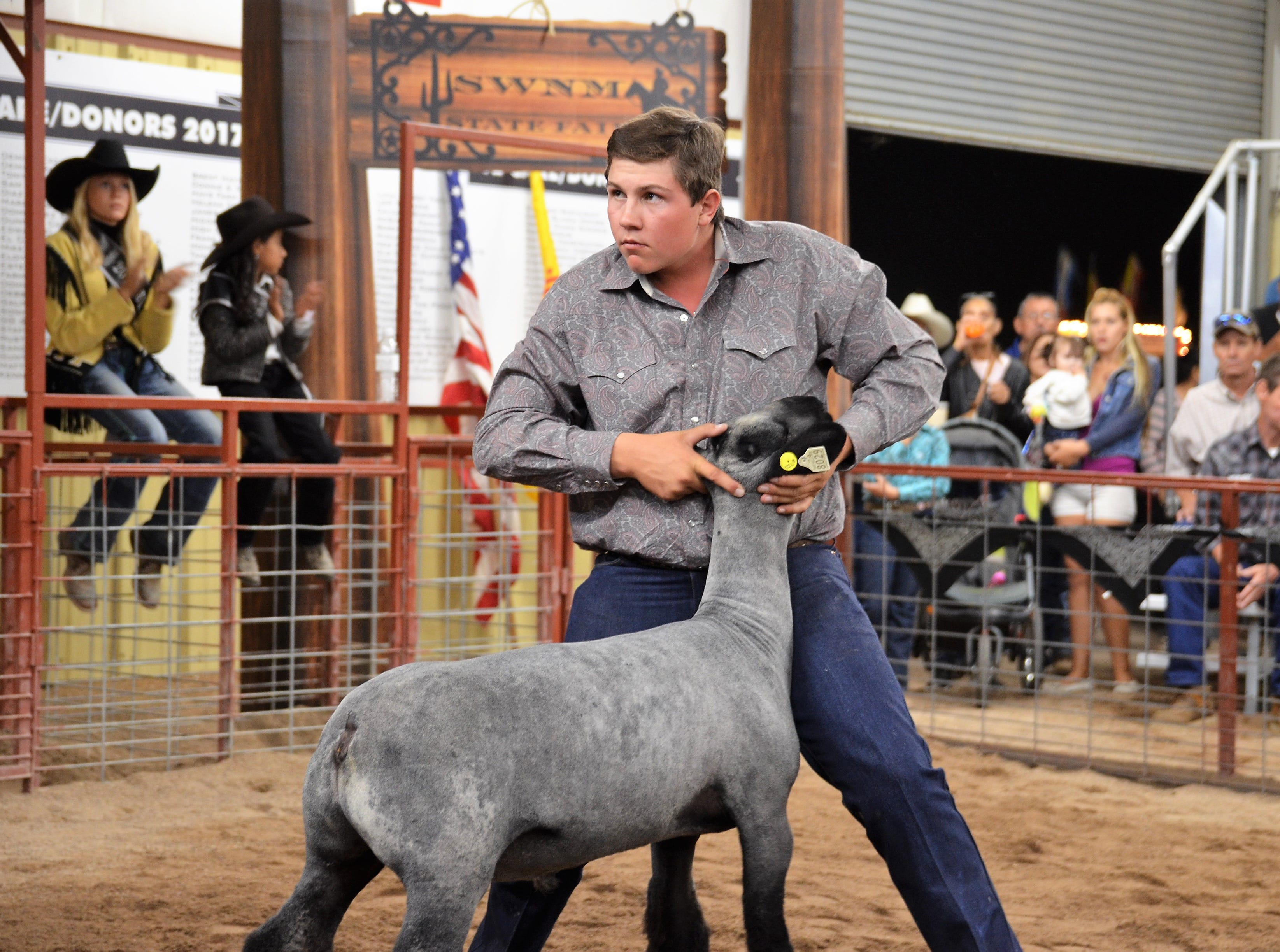Tanner Caldwell displaying his Second Place Class 3 Lamb