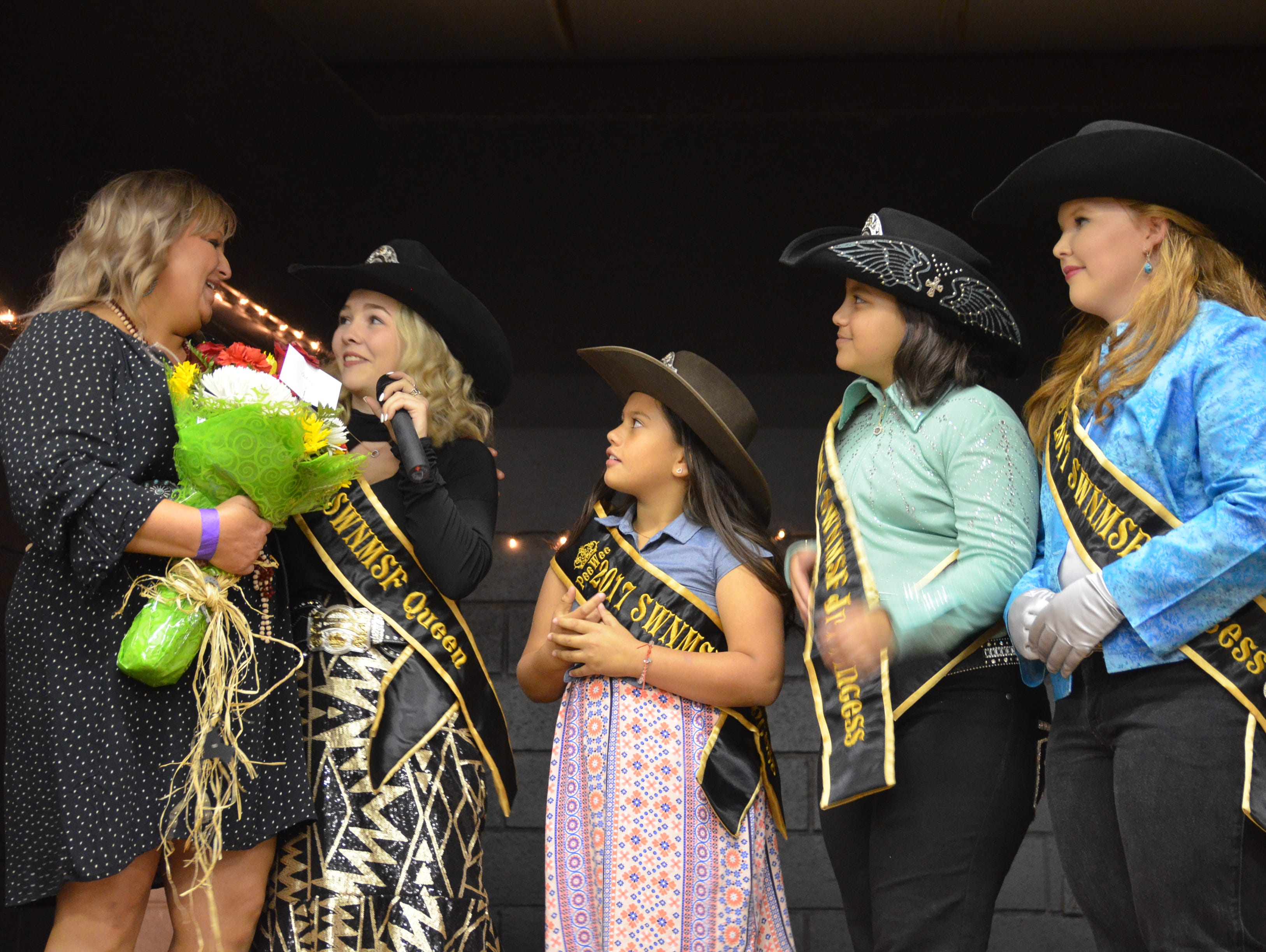 Former SWNMSF Queen and Princesses give thanks to mentor Britney Power during the 2018 SWNMSF pageant Thursday.