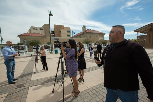 Steve Montanez, right, former Las Cruces City Council candidate, shouted questions to a group of Democrats gathered for a news conference Thursday, Oct. 11, 2018 at Plaza de Las Cruces. The conference was called for by State Rep. Bill McCamley, left, to a address a report that raised questions about U.S. Rep. Steve Pearce, R-N.M. and the oil industry equipment companies the gubernatorial candidate owns.