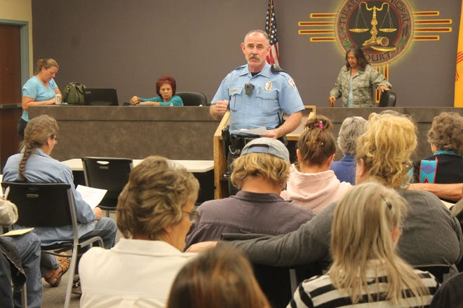 Approximately 50 people gathered to discuss concerns about crime in Tularosa and the logistics of forming a neighborhood watch group. The meeting was organized by Tularosa Police Department Chief Chuck Wood, shown here addressing the attendees.