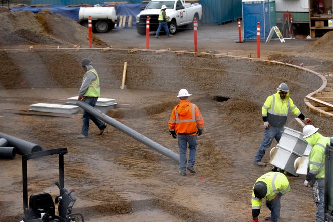 Workers keep busy during construction of the new Brookside Bay Water Park on Thursday at Brookside Park in Farmington.