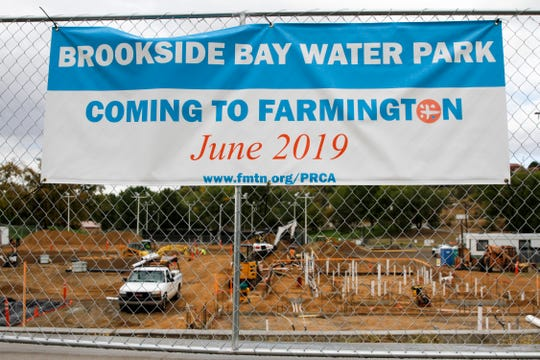 A banner Thursday advertises the opening month for the new Brookside Bay Water Park at Brookside Park in Farmington. The facility is scheduled for completion in May 2019.