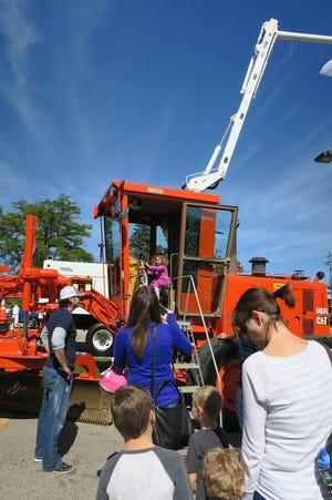 Kids especially enjoy climbing into the township's heavy trucks at the open house.