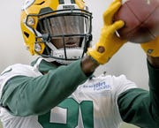 Green Bay Packers wide receiver Geronimo Allison catches a machine-fed ball during practice inside the Hutson Center on Oct. 11, 2018