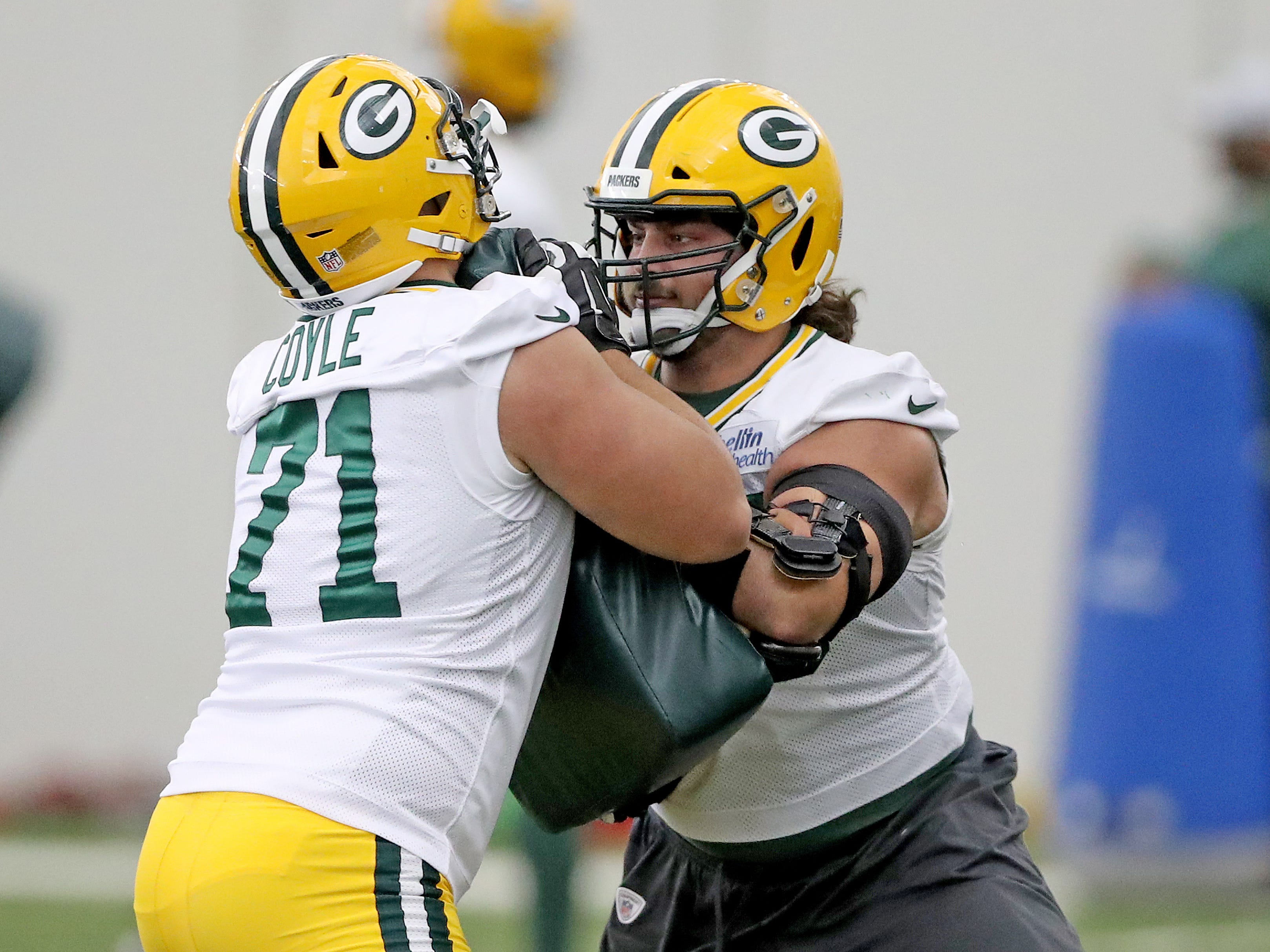 Green Bay Packers offensive tackle David Bakhtiari (69) spars with guard Anthony Coyle (71) during practice inside the Hutson Center Thursday,October 11, 2018 in Ashwaubenon, Wis.