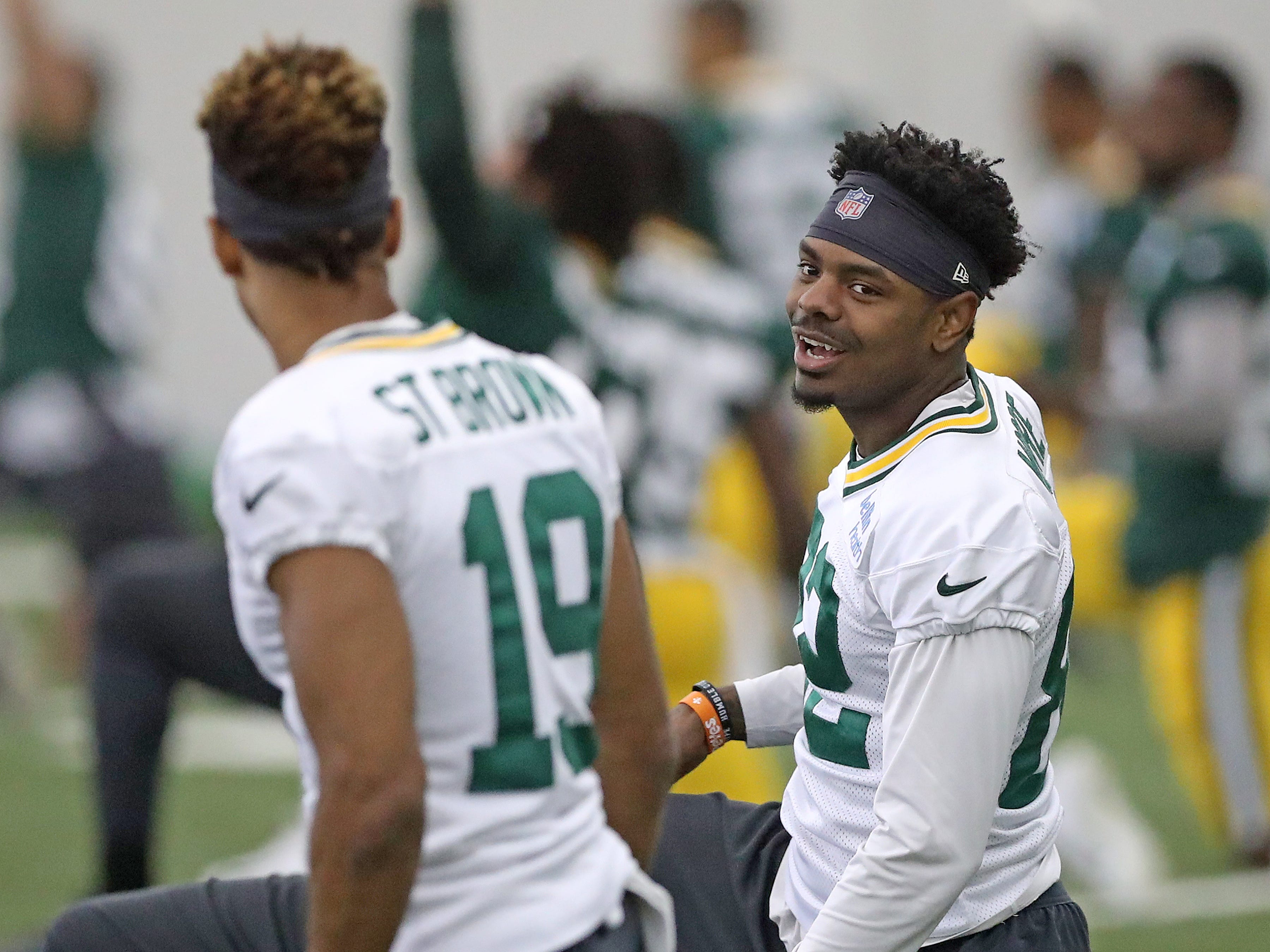 Green Bay Packers wide receiver J'Mon Moore (82) talks with wide receiver Equanimeous St. Brown (19) during practice inside the Hutson Center Thursday,October 11, 2018 in Ashwaubenon, Wis.