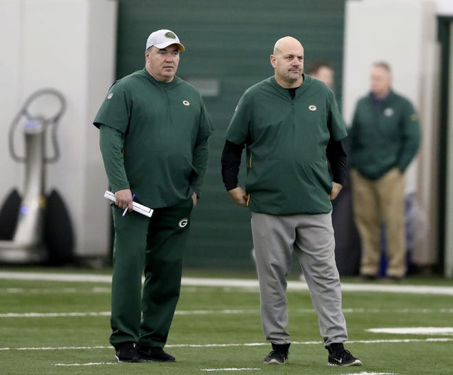 Now former Green Bay Packers head coach Mike McCarthy looks on with defensive coordinator Mike Pettine during practice inside the Hutson Center on Thursday, October 11, 2018 in Ashwaubenon, Wis.