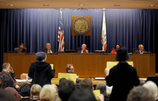 The California Public Utilities Commission meets in San Francisco on Dec. 18, 2014.
