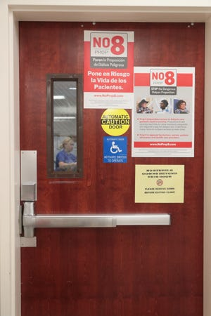 'No on Prop 8' signs are featured on a door in a DaVita Dialysis center in Cathedral City, Calif., October 11, 2018.