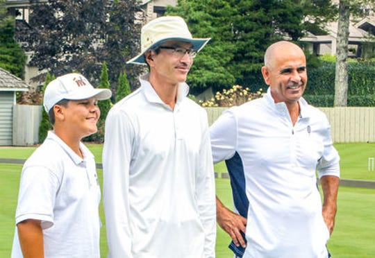 Blake Fields (left), an 11-year-old croquet prodigy from Rancho Mirage, stands next to top American players Jeff Soo (middle) and Sherif Abdelwahab.