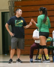 Coachella Valley volleyball coach Carlos Contreras congratulates Cheyenne Sandoval during a win earlier this year.