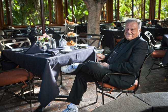 Harold Matzner, philanthropist and owner of Spencer's Restaurant, enjoying a cocktail on the patio.