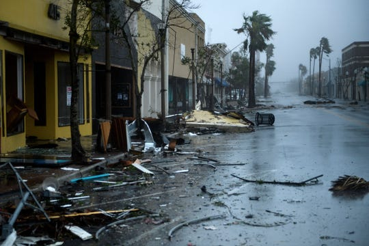 "A view of storm damage during Hurricane Michael October 10, 2018 in Panama City, Florida. - Michael slammed into the Florida coast on October 10 as the most powerful storm to hit the southern US state in more than a century as officials warned it could wreak ""unimaginable devastation."" Michael made landfall as a Category 4 storm near Mexico Beach, a town about 20 miles (32kms) southeast of Panama City, around 1:00 pm Eastern time (1700 GMT), the National Hurricane Center said."