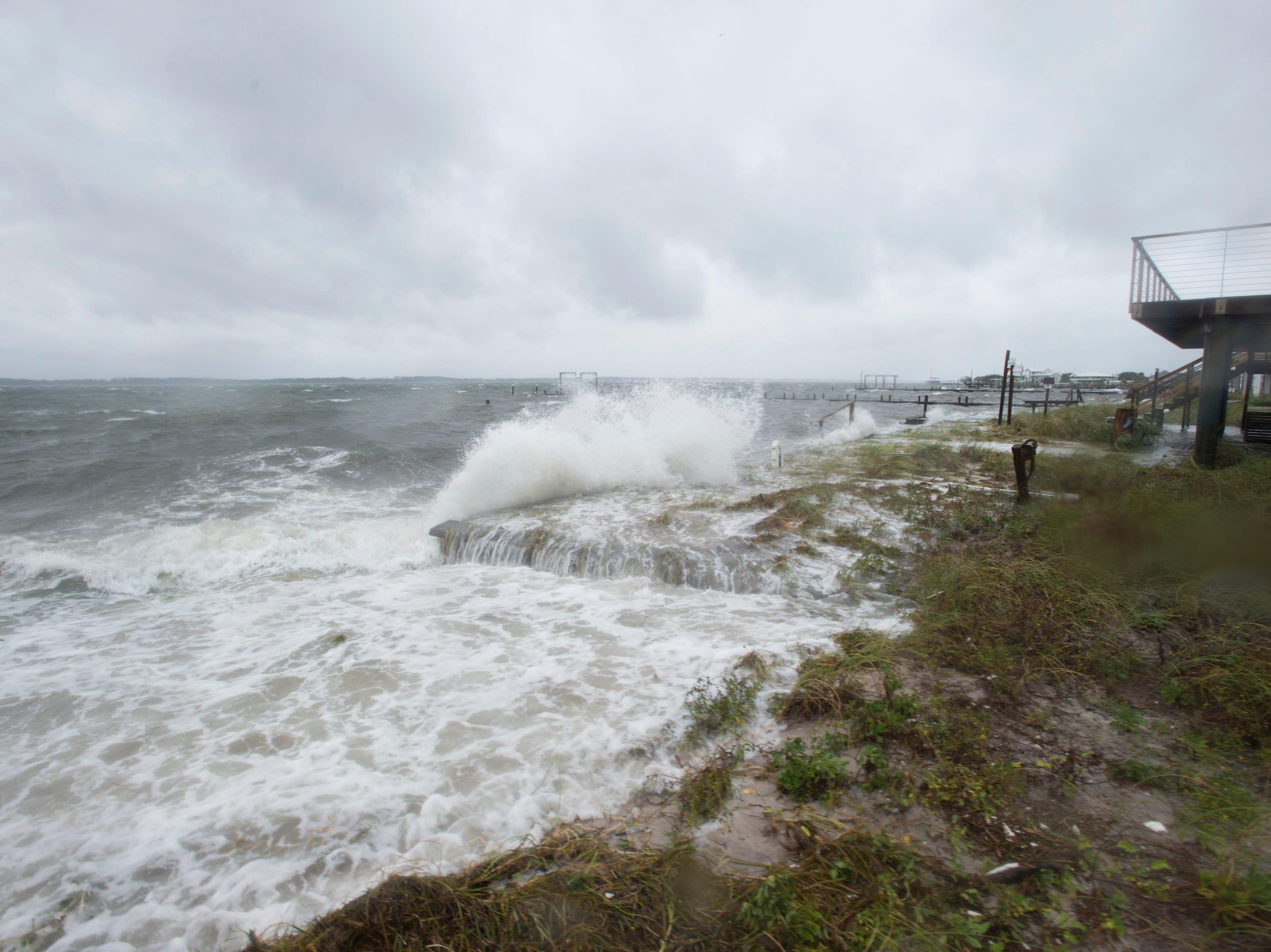 Water crashes the shore along Panferio Drive in Pensacola Beach as Hurricane Michael blows through the area on Wednesday, October 10, 2018.