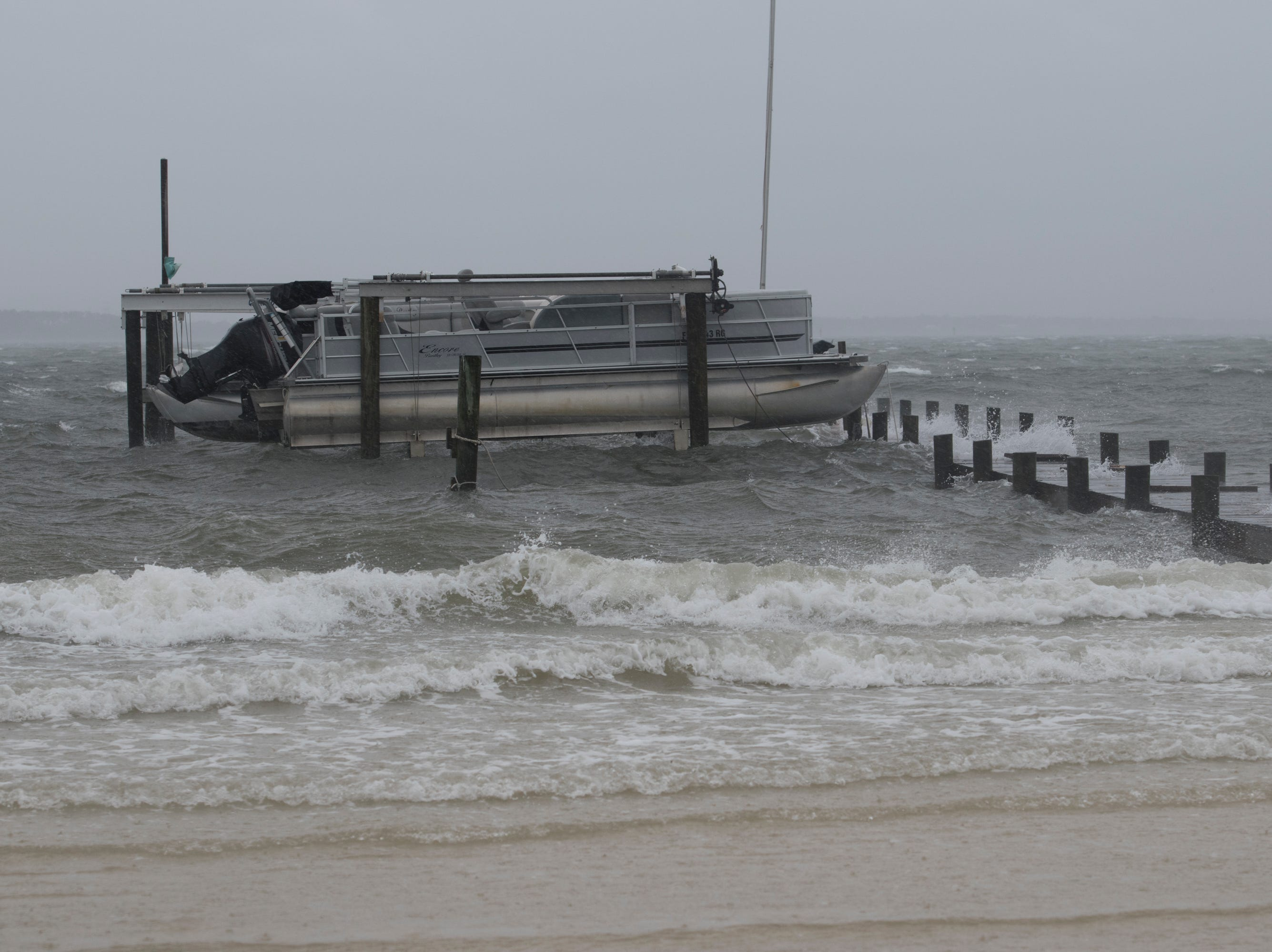 Rough water pounds the dock at Quietwater Beach as Hurricane Michael makes its way through Pensacola on Wednesday, October 10, 2018.