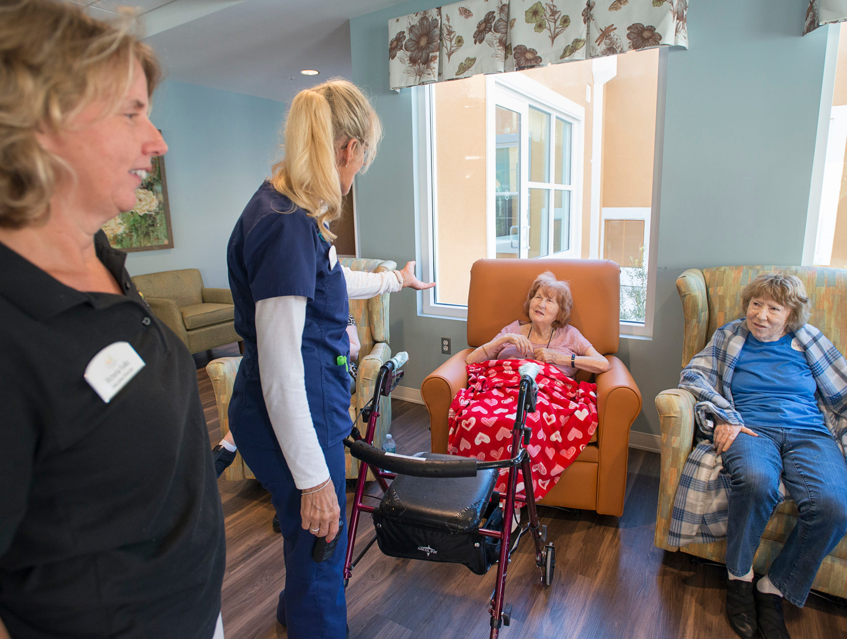 Executive director Victoria Folks, left, and nurse Linda Cooper chat with their Seagrass Village of Panama City Beach residents Ann Kernan, right, and Una O'Connor as they temporarily stay at The Arbors in Gulf Breeze on Thursday, October 11, 2018.  Seagrass residents and staff were evacuated ahead of the storm to this sister community in Gulf Breeze.  Cooper hasn't been able to contact anyone back in Panama City and still doesn't know the fate of her home.