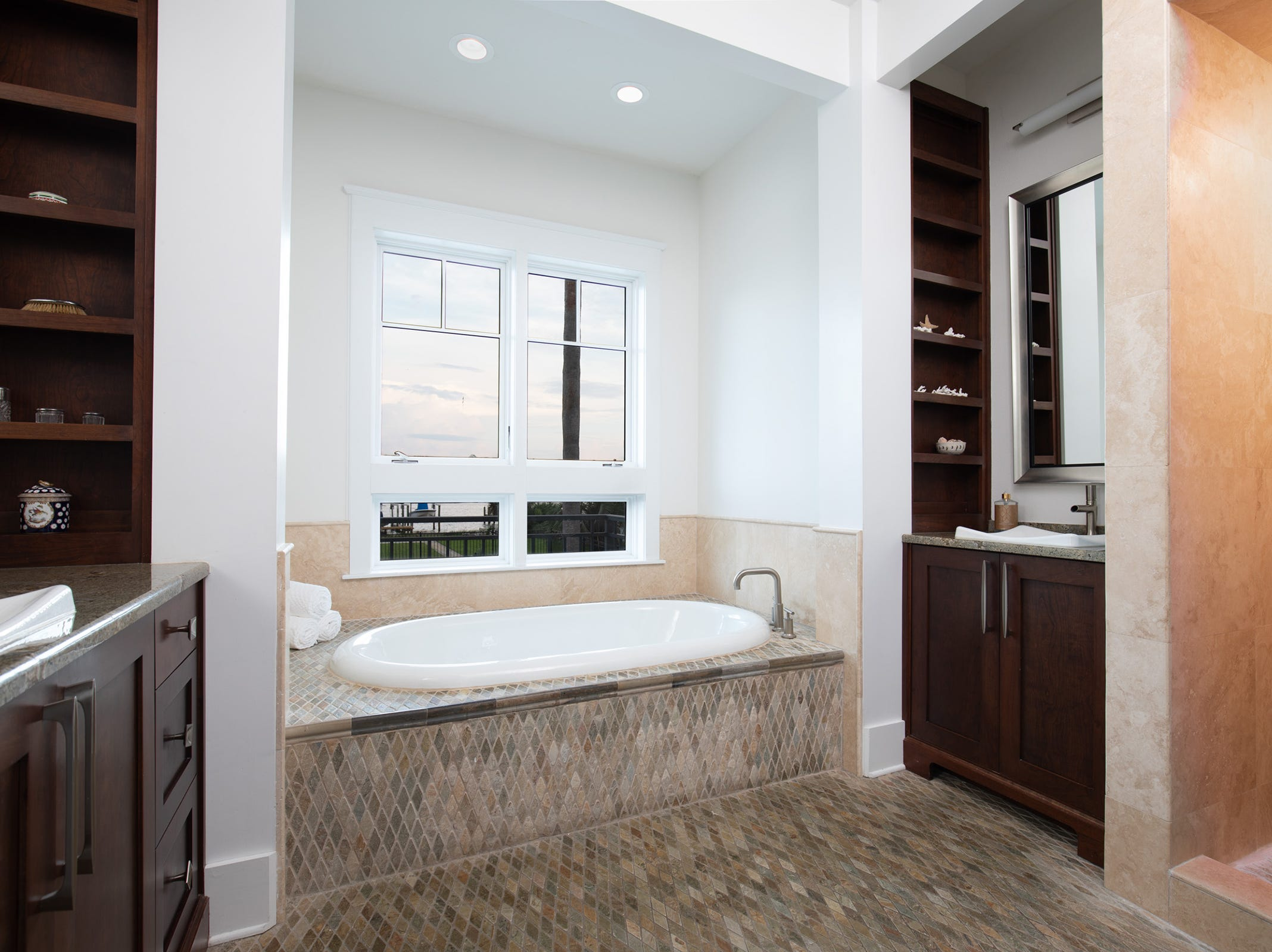 200 Sabine Drive, the master bath is your home spa.