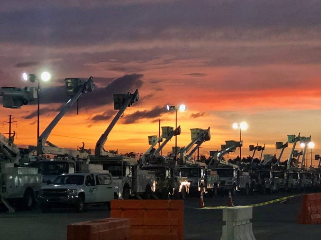 Gulf Power trucks line up at the Pensacola Interstate Fairgrounds ahead of Hurricane Michael. Crews are deployed to the area as of Thursday, Oct. 11, 2018.